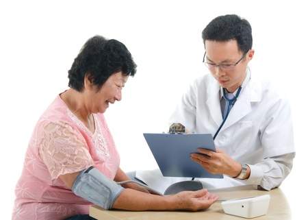 south asian ethnicity: asian senior female medical checkup with doctor ,south east asian chinese ethnicity