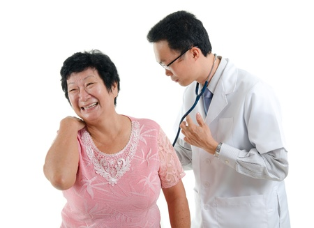 asian senior female back pain medical checkup with doctor ,south east asian chinese ethnicity photo