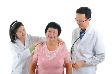 south east asian: asian senior female medical checkup with doctors ,south east asian chinese ethnicity