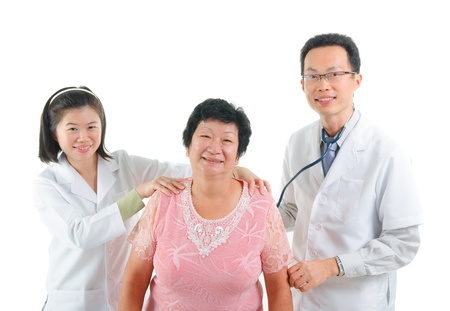 asian senior female medical massaga checkup with doctor ,south east asian chinese ethnicity photo