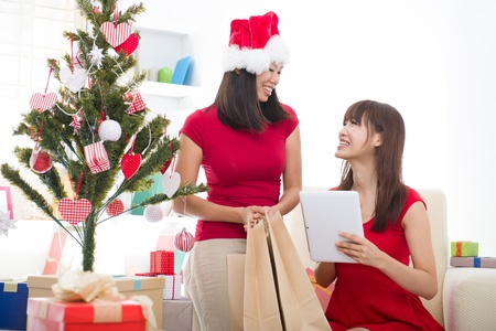 asian girls christmas online shopping Stock Photo - 16926240