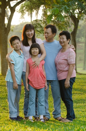 asian family outdoor enjoyment and quality time, full body photo