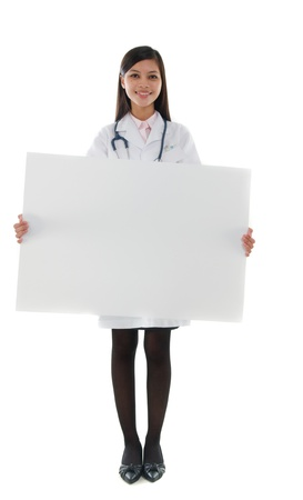 asian hispanic doctor woman holding blank cardboard photo