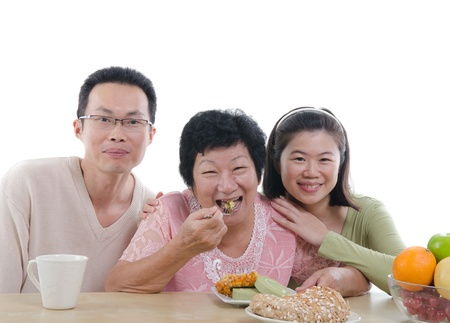 asian family meeting eating healthy snack  photo