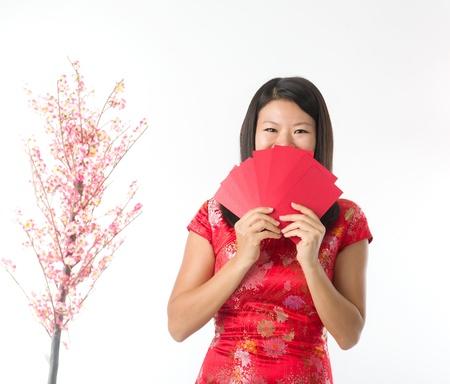 ang: Happy Chinese new year asian girl. Asian girl holding ang pao Stock Photo