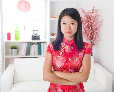 girl in red dress: chinese new year girl lifestyle photo, with decorations on background