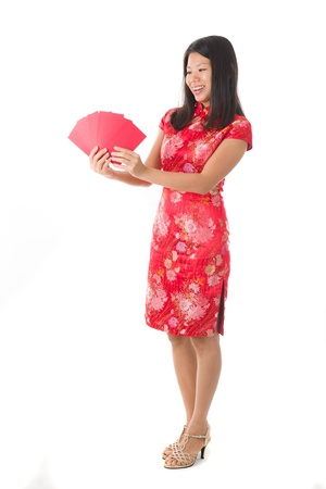 chinese new year girl ang pow red packet isolated in white, full body photo