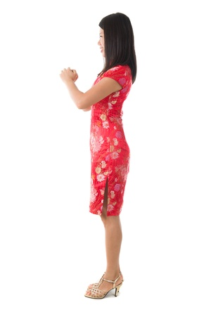 chinese new year girl greeting isolated in white, full body photo