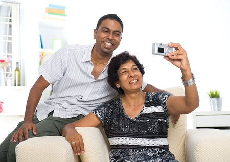matured: indian family lifestyle photo , son and mother taking self photo