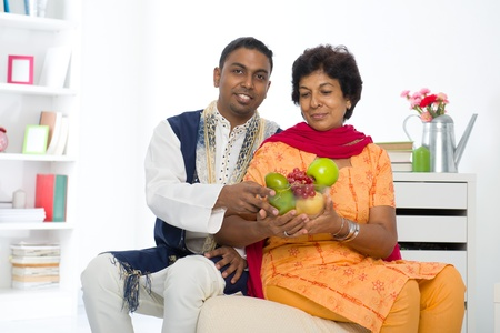 dhoti: healthy punjabi family ,mother and son with traditional punjab dress