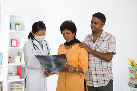 old man on a physical pressure: indian punjabi family senior doctor appointment medical checkup  Stock Photo