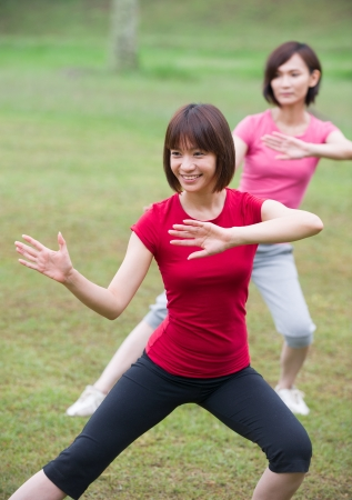 tai chi: asian girls tai chi outdoor , chinese women