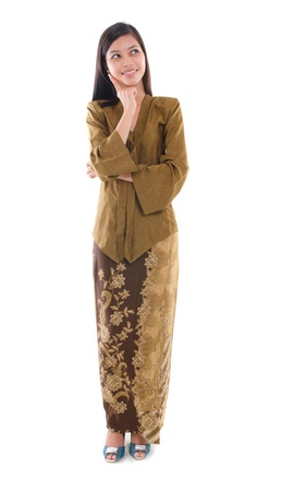 adult indonesia: south east asian female in kebaya dress, malay ethnicity isolated on white Stock Photo