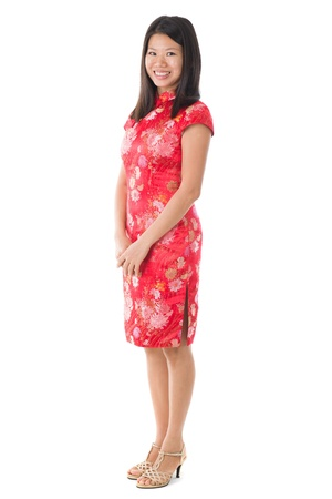 chinese dress: chinese new year girl standing an smiling Stock Photo