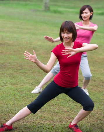 asian girls tai chi outdoor , chinese women  photo