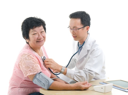 old man on a physical pressure: asian doctor doing medical check up