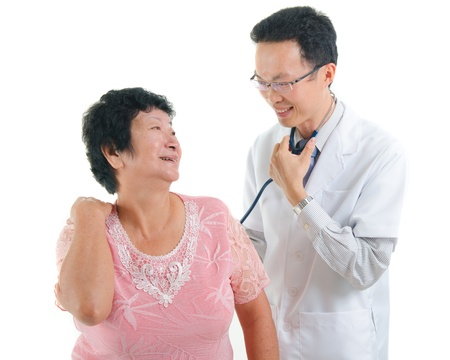 south asian: asian senior female medical checkup with doctor ,south east asian chinese ethnicity