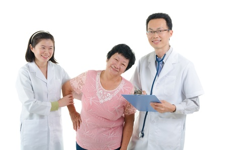 south asians: asian senior female medical checkup with doctors ,south east asian chinese ethnicity  Stock Photo