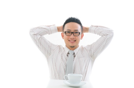 contempory: chinese business man having coffee