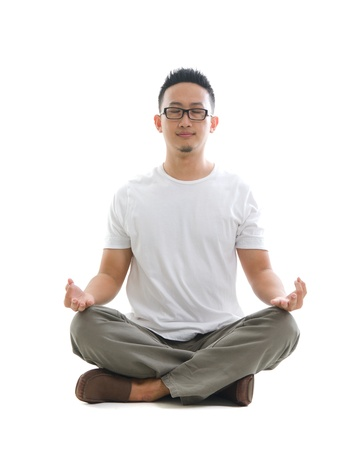 asian male doing yoga relaxing Stock Photo - 17046575