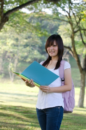 asian college girl studying outdoor , chinese woman photo