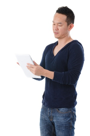 south east asian man with a tablet in casual , half body photo