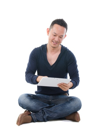 south east asian manwith a tablet in casual  Stock Photo - 17046576