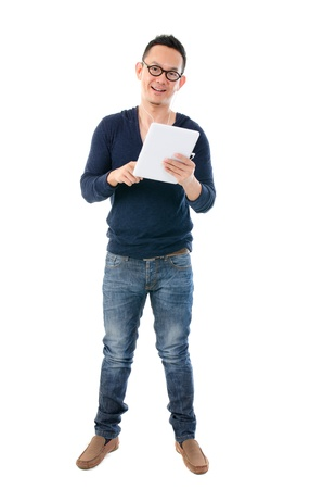 south east asian man	with a tablet in casual standing
