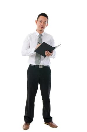 asian business man writing notes Stock Photo - 17046526