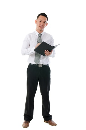 asian business people: asian business man writing notes Stock Photo