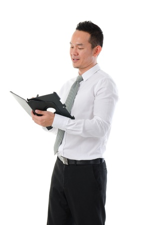 asian business man writing notes Stock Photo - 17046596