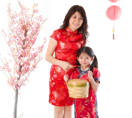 chinese family: chinese new year family mother and daughter celebration photo