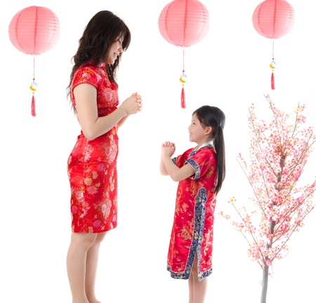 chinese new year family mother and daughter greeting Stock Photo - 17046850