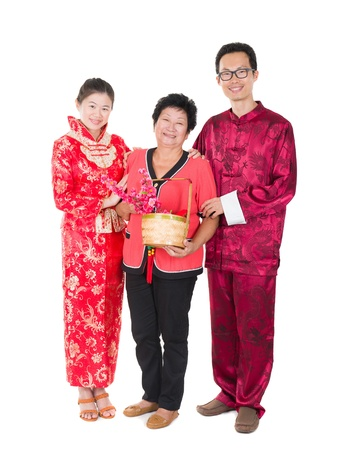 chinese new year family with ang pow symbol of luck photo