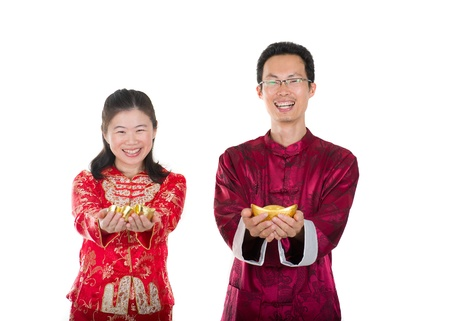chinese dress: chinese new year couple with gold coins during festival Stock Photo