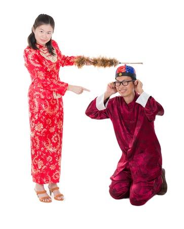 asian bride punishing his groom photo