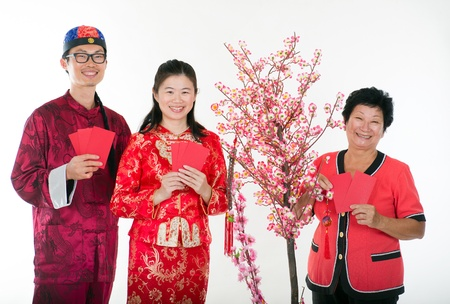chinese new year family with ang pow photo