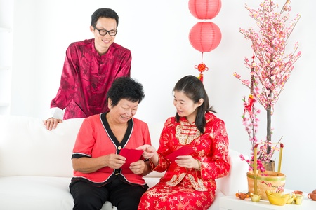 chinese new year family with ang pow Stock Photo