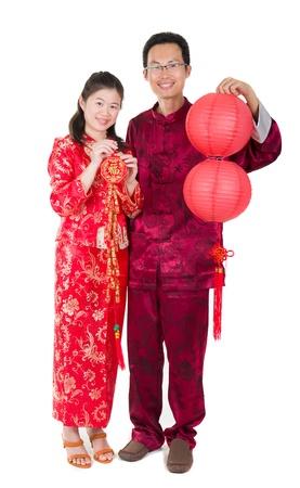 cheongsam: asian couple celebrating chinese new year