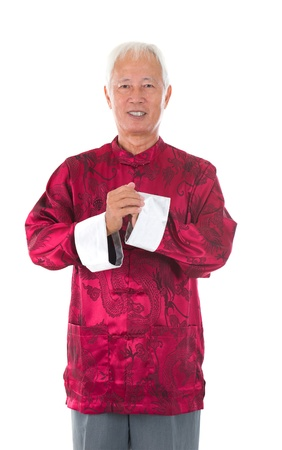 asian  senior chinese man celebrating lunar new year, with traditional clothing Stock Photo - 17385809