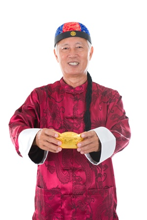 senior chinese man with gold bullion and traditional chinese clothing photo