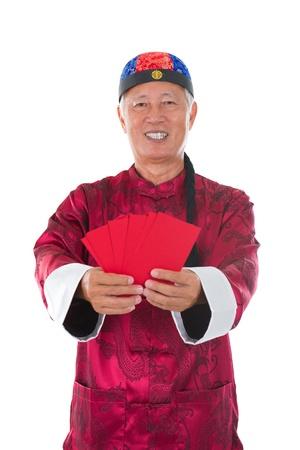 ang: asian senior chinese male holding ang pow