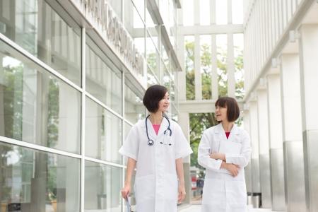 south east asian female doctors walking