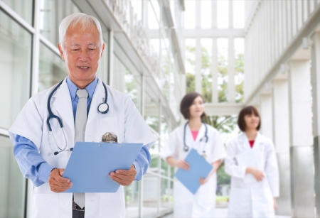 hospital notes: chinese senior male doctor in hospital Stock Photo