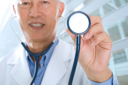 south east:  close up of asian senior doctor focus on  stethoscope