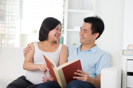 asian wife: pregnancy husband and wife lifestyle reading book