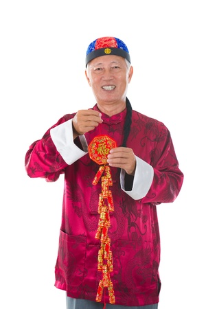 chinese senior playing with fire crackers photo