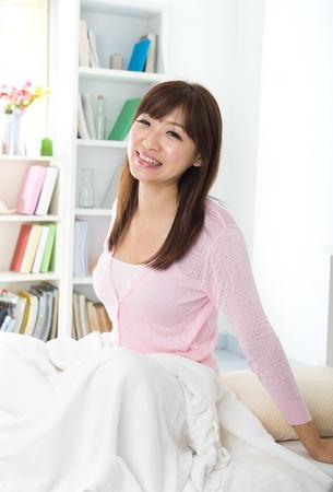 chinese asian girl waking up from sleeping  Reklamní fotografie