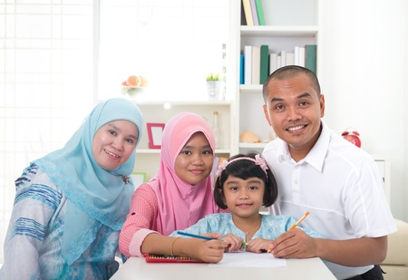 indonesian malay family doing homework together, quality time photo