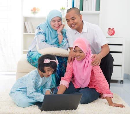 indonesian malay family having a good time surfing internet photo